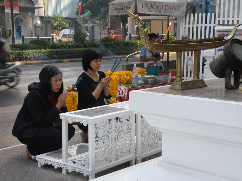 Devotees praying to Lord Indra. You see the main road in the background. What I liked about Thailand is that it is very clean.