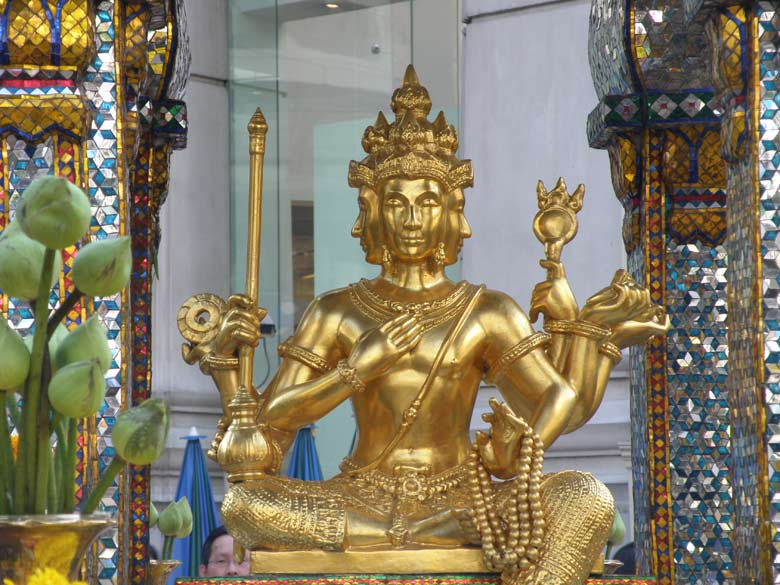 A close up view of the Brahma image. The 4 faces of Brahma represent the Four Divine States of Mind. Brahma has four has four arms, he holds a lotus flower, his sceptre, his bow parivita, a string of beads, a bowl containing holy water and the Vedas. He has four heads and is therefore called Chaturanana or Chaturmukha. The 4 faces represent the 4 Vedas.