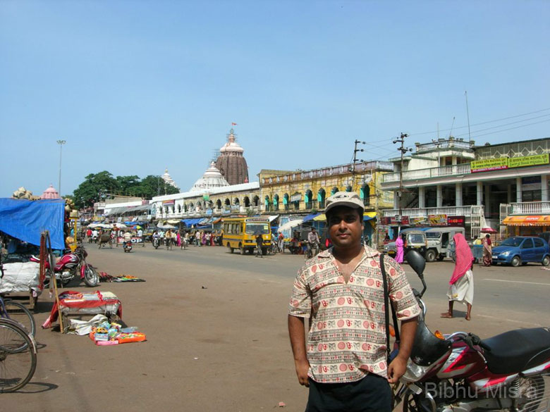 That's me standing on the Grand Road, in the morning after the Ratha Yatra. It's a 2 km long road which connects the Jagannath Temple to the Gundicha Temple. The Jagannath Temple is one of the four important places of Hindu pilgrimage (Char Dham).