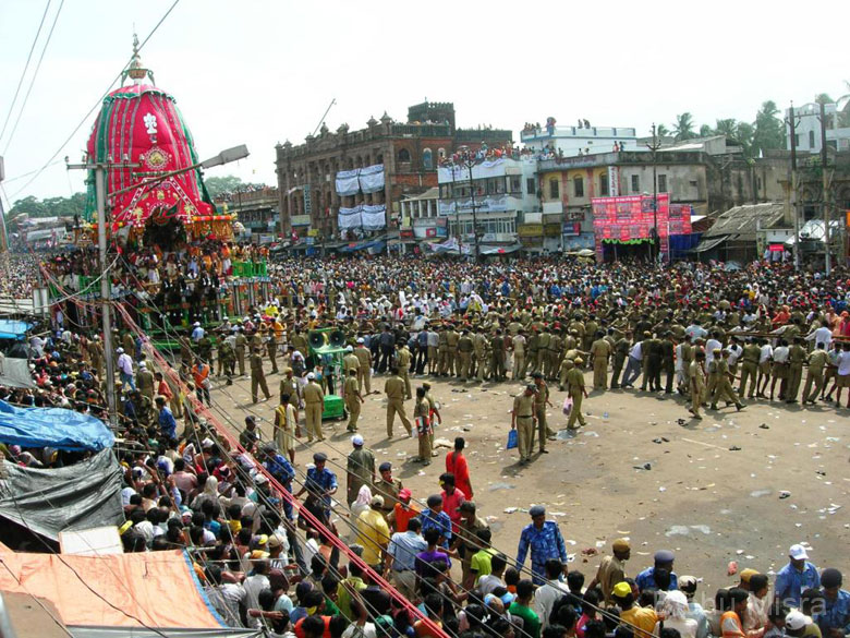 We watched the Rath Yatra from the balcony of a hotel on the Grand Road, for a nominal charge. We were actually lucky to be allowed in since most of the places were already full. The first chariot was that of Balarama``s. The chariots stop at many places along the way, to enable the devotees to catch a glimpse of the deities. The police play a very important role in clearing the area in front of the chariots, and guiding the ropes, which are pulled by the devotees.