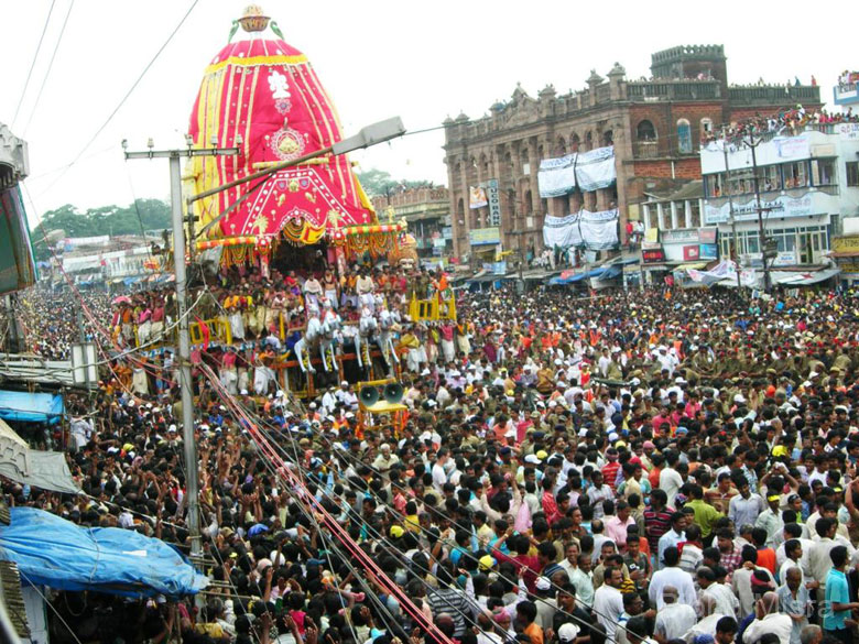 Finally its Jagannath````s chariot. The crowds swelled up considerably, and there was loud chanting and singing, beating of drums and blaring of trumpets. It is said that anyone who is present during the Rathayatra festival gets absolved of all sin.