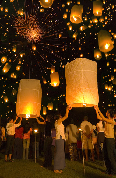 You see Thai people with lanterns. The floating of lanterns, which began in the Sukhothai period, continued throughout the different stages of Thai history. In India people place lanterns outside their homes, at the window and on the street during the festival of Diwali although the lantern design may differ from what you see.
