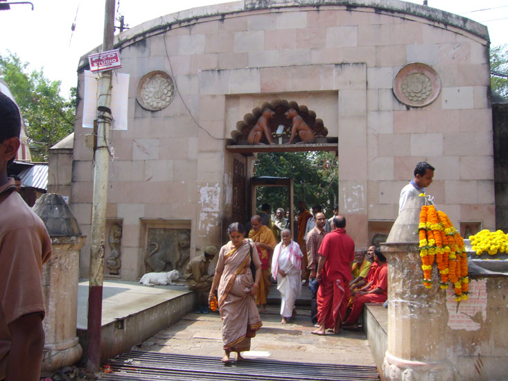 Entrance to the temple. Kamakhya Temple is regarded as one of the 51 Shakti Peethas. As per tradition, during the time of self-sacrifice, the genital organ (yoni) of Sati fell at this spot. Kamakhya Mandir is a natural cave with a spring. In order to reach the temple, one has to take a flight of steps that goes down into a dark and strange shrine.