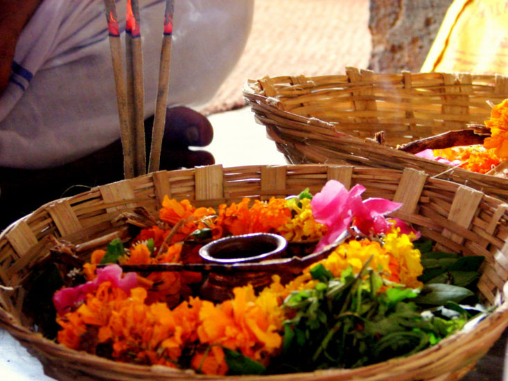 Fresh flowers, tulsi leaves, incense sticks, holy water - the ritual package.