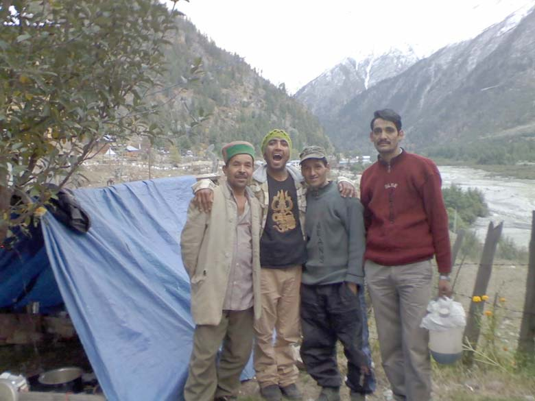 Kullu or Kinnaur, Himachulis all, Guest House owner, cook, trekking guide and driver, posing together for a happy picture. Kitchen house tent at the back! And truly delicious meals to fight altitude sickness with high calories and proteins, topped with hot chocolate at night! Also, hot water bags in bed each night, to ward off the harsh nighttime chill.