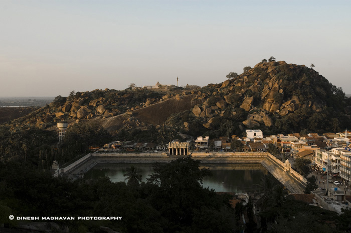 The view of the mammoth Water tank from the Indragiri hill. `Shravana` means `Jain monk` and `belagola` means `white pond`.