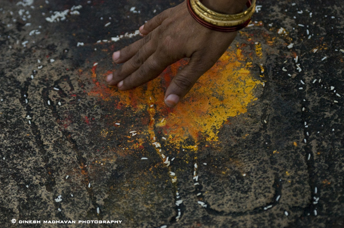 Pilgrims showing reverence, by touching the foot marks of a Jain ascetic on the way to the top of Indragiri Hill.