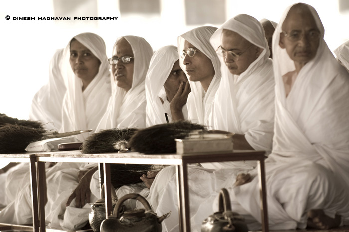Digambara Jain nuns in observing the ritual lustration of the magnificient icon of Bhagavan Gommateshvara Bahulbali.