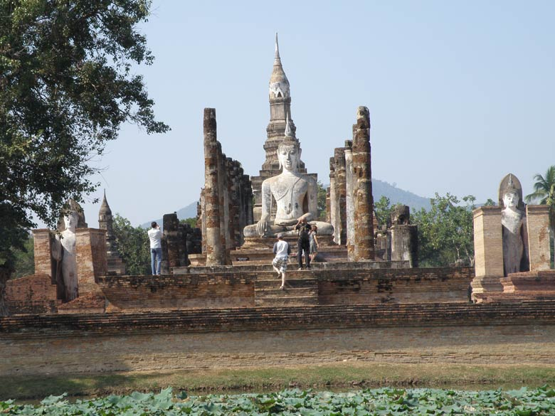 Most monuments are in the Sukhothai Historical Park. Sukhothai is about 5-6 hours bus drive from Ayutthaya. The key monument is Wat Mahathat that you see. The complex has about 200 chedis (stupas) and a large lotus-bud chedi that you behind the image of Buddha. The chedi was rebuilt by King Lo Thai in mid 14th century to hold Buddha relic - a hair and neckbone fragment that he picked up in Sri Lanka.
