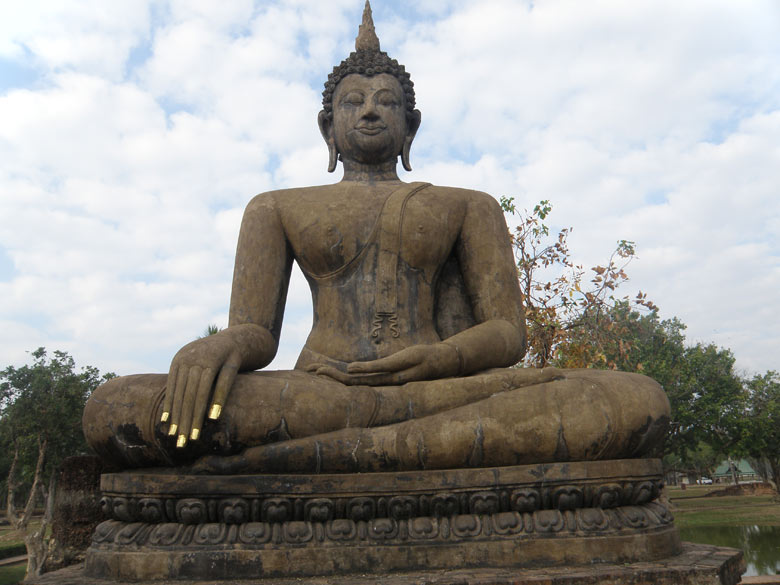 Just behind the main chedi is a huge Buddha image that you see `Calling the Earth to Witness`. Like others it has stone pillars in front that would have once supported a ceiling. Very impressive image. Note the incredibly tapered set of fingers.