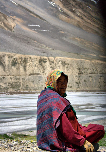 A local sitting next to the Spiti River in Kaza, Spiti Valley