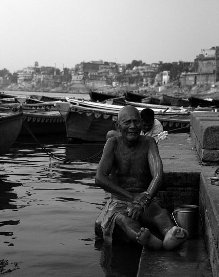 An old man bathing on the ghats of Varanasi.