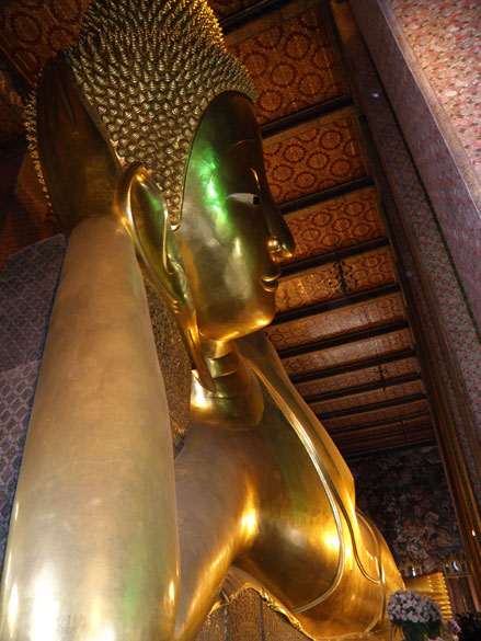 You see image of reclining Buddha from head to his feet. Image is 46 metres long, 15 metres high and covered in golden leaf.