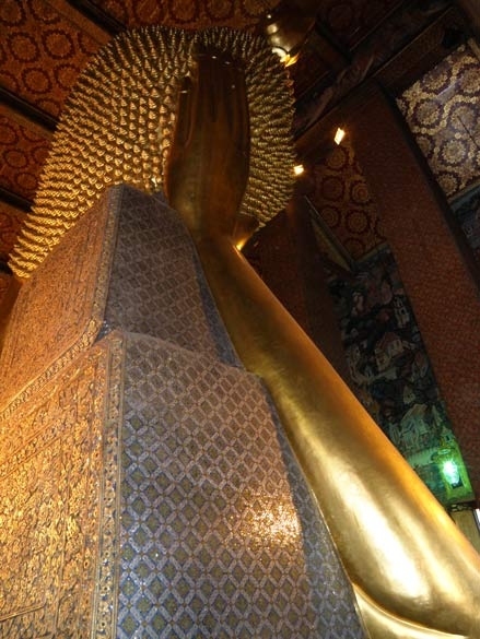 Hand and head of reclining Buddha.