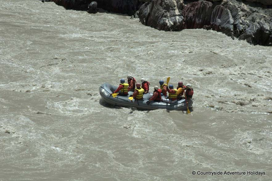 Getting into the wild and exciting river Zanskar. `The walls of the Canyon go up thousands of feet off the river bed`.