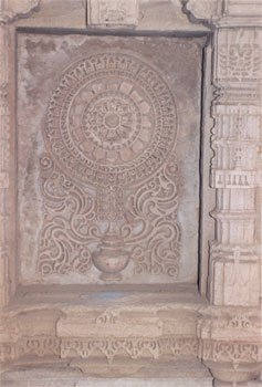 Next to that is a Yantra carving.