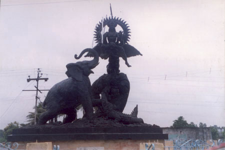 The sculpture is of Gajanand Moksh in the centre of a road crossing. The  Gajanand Moksh mandir is just a short distance from this point and is near the banks of the river where you see the boats.