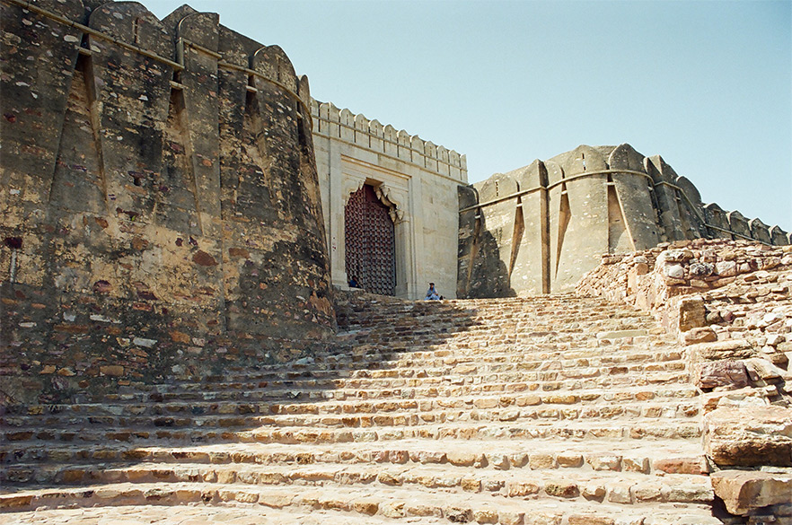 The traditional entrance is from the east whose picture you see, was meant for coming on horse or by foot. There were seven gates of which only two remain. Below this entrance are fields ending with mountains. Today you drive into the fort from the western side.