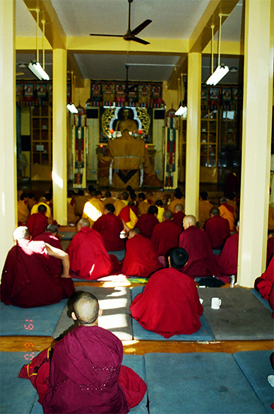 Monks inside the main hall of the Dalai Temple Complex.