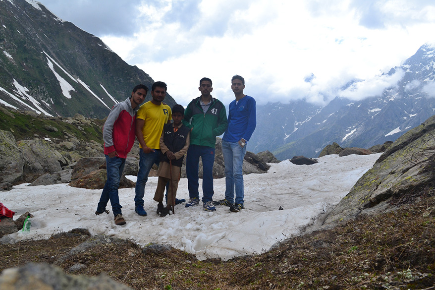 Me and my friends along with our little guide at Brahm Sarovar (Brahma peak)