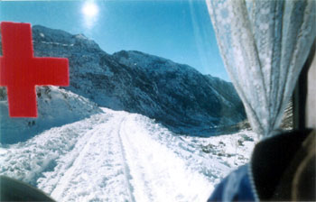 View of snow covered road from the vechile