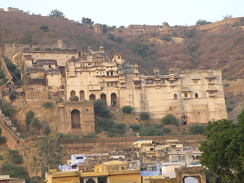 An evening close up view of the Bundi Palace with old city in the forefront.