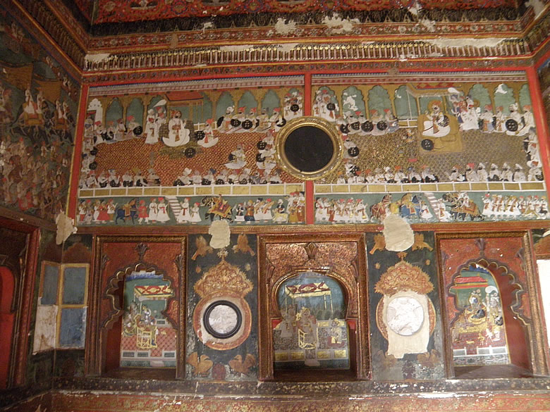 Paintings of Chatra Mahal. Court scene with Bundi Maharaja with others. This palace is famous for finest minitiature murals. There is extensive use of Red, gold, blue colors with glass and ivory work esp on the gates.
