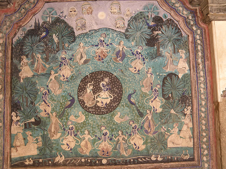 This is Maharas shows Lord Krishna with the Gopis. You see a Lord Krishna with Gopi in the center and in the outer circle. The Lord is shown in blue color.