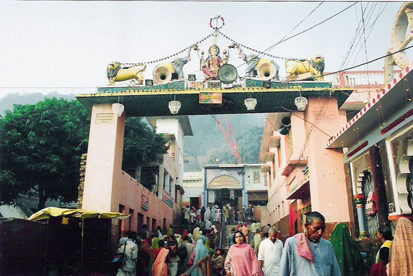 A must do is the parikrama of the holy mountain Kamadgiri. It is a forested hill that is skirted all along its base by a chain of temples and venerated today as the holy embodiment of Shri Ram. The Bharat Milap mandir is located there marking the spot when Bharat is said to have met Rama to persuade him to return to the throne of Ayodhya. We started at about 6.30 am. It is a 5-6 kms walk. There were hundreds of people along with us. You see a big temple in this picture. It is the point where the Parikrama starts.