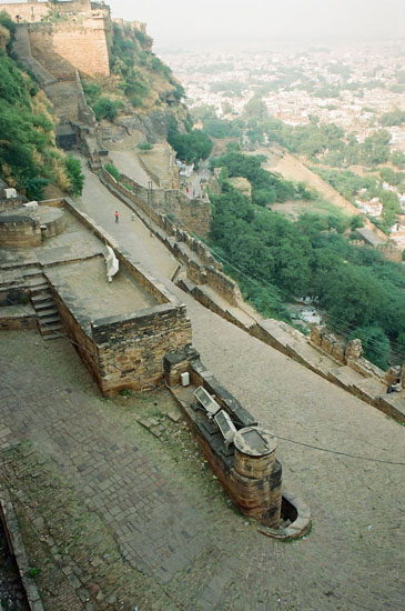 You can enter the fort from the Gwalior Gate (i.e. steep climb) or the Urvayu Gate i.e. a car takes you uphill on a tarred road. You see the steep path that has six fortified gateways. The fort is situated on the Gopachal mountain, has 10 gates of which only two are operational. It has eight tanks, six palaces and six temples.