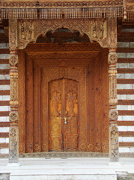 The wood carved door of the Saraswati temple