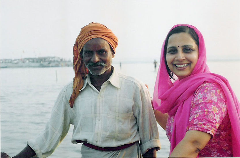 Wifey with our boat man Om Prakash. We gave him an Rs 50/ tip for bringing us to the holy Sangam. In the background you can see a blurred structure. Well you can reach that point by walking from the ghat and then walk your way here through the water.