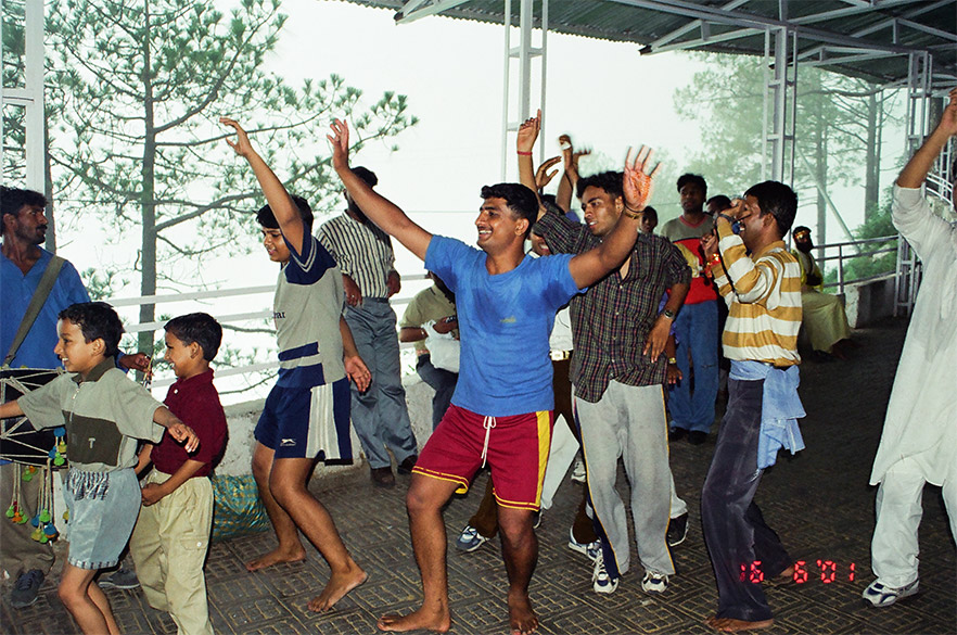 Devotees dancing enroute. Enroute you will find people who play the Dholak for you. We saw many small groups dancing their way through. The happiness on everyone`s faces was a pleasure to see.
