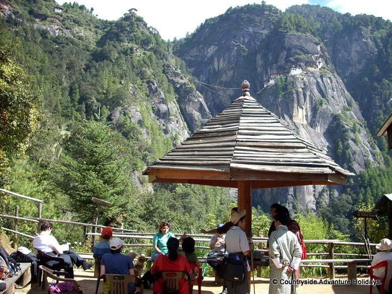 Tourists at the base point enroute to Tiger Nest``s monastery where the revered sage Guru Rimpoche meditated for 3 months months. U see the monastery on right of picture in the cliff. The monastery is called Taktsang Lhakhang and is one of the most piligrim place for the Mahayana Buddhist.