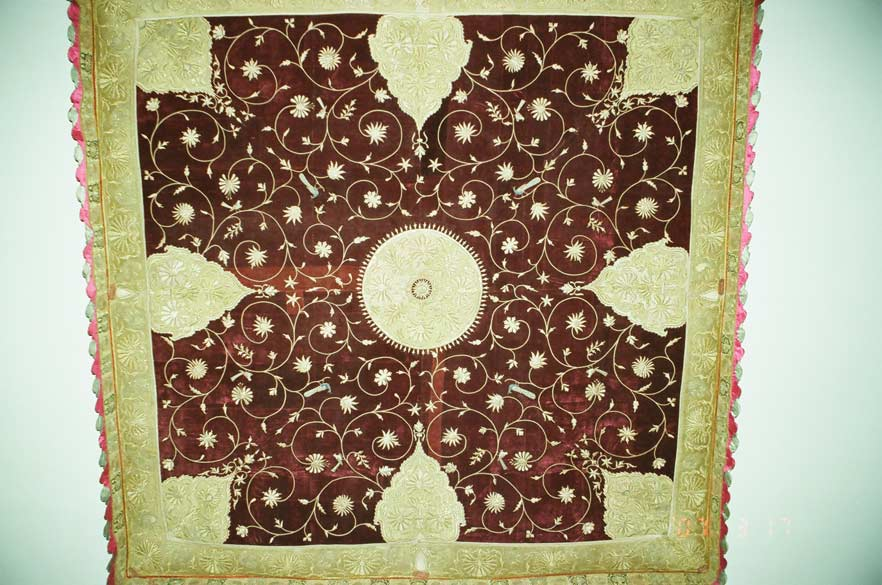 A close up of the red carpet that adorns the ceiling of the Durbar Hall. There is a tea lounge to the right of the Durbar Hall from where you get a great view of Pichola Lake.