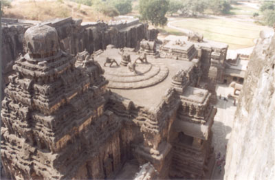 Picture from northeastern side taken from the hill above the temple. Left to right note the Vimana, main temple, manadapa 2 where Shiv`s carrier Nandi is housed and the entrance at the end. Extreme right see the courtyard with column below.