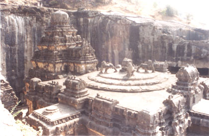 A closer look from north side of the top of the main temple and vimana behind. Below the main temple is a main hall supported by 16 pillars carved in 4 rows with floral & animal design. There are pillared porches on north south side that provide a balance to the temple.