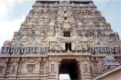 A closer view of the western gopuram. King Vikrama Chola (1118-1136 a.d.) commenced constructing the west gopuram was finished by Sundara Pandya s & is thus called by that name. He also built a golden hall in the temple and provided it with a golden roof.