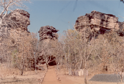 Bhimbetka Rock Shelters 46 kms from Bhopal. Surrounded by the Northern fringe of the Vindhyan ranges, Bhimbetka is an archaeological treasure. In this rocky terrain of dense forest there are over 700 rock shelters belonging to the Neolithic age. Paintings in over 500 caves depict the life of prehistoric cave dwellers. Executed mainly in red & whote with the occasional use of green & yellow, these paintings usually depict hunting, dancing, music, animal fighting & household scenes