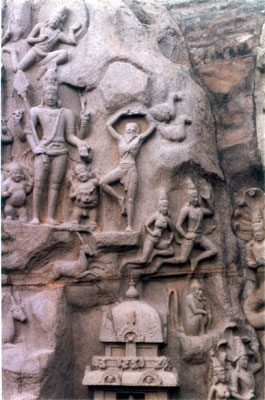 Arjuna s Penance. The two rocks to a length of 90 feet with a narrow fissure in between are used to depict the story of Arjuna s penance for is desired boon of Pasupata astra from Lord Shiva. This event is witnessed by Lord Shiva (extreme left) in standing form with his upper arms holding trishula & mazhu and the lower right arm in the gesture of giving boon. Below the Lord are his two ganas (dwarf attendants). In the center of the picture the man standing on his left leg & raised hands is Arjuna, his severe penance is shown by his prominent rib bones & long beard. Surya (above Lord Shiva) & Chandra (not in picture) with celestial bodies witnessing the event. A number of animals like deer, jackal, monkey are shown in a wild, dramatic manner.