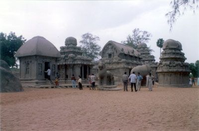 Overview of the 5 Rathas or monolithic temples. Chiseling work starts from top to bottom. A small hill sloping from south to north has been segmented into five divisions & converted into monolithic temples. Each monolithic temple shows different kind of sikhara. The five rathas are Dharmaraja Ratha, Bhima Ratha, (center huge structure), Arjuna Ratha (left of Bhima ratha), Draupadi Ratha (extreme left) and Nakul Sahadev Ratha (extreme right).