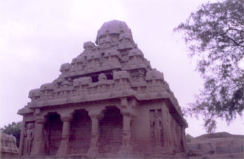 Dharmaraja ratha - this southernmost monolithic temple is the highest in the group. It is having square base and series of diminishing tiers to a total number of three with octagonal sikhara at the top. Each storey is demarcated from the other by a convex roll cornice with chaitya-window arches & small pavilions surround the upper storeys. The temple is dedicated to Lord Shiva.