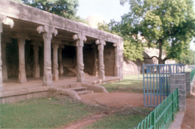 The Krishna mandapa actually contains the panel of Krishna as Govardhanadhari. Its bas-relief portrays how Lord Krishna protected the cowboys and their cattle from the onslaught of thunder. Krishna is seen in the center as holding the Govardhana hill with his left arm. What you see is the entrance to the mandapa. Note that the rock boulder is huge, starts with Arjuna s bas-relief that you saw in pic 1 and ends with this mandapa.