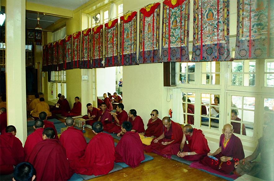 A closer look of the monks inside the hall.