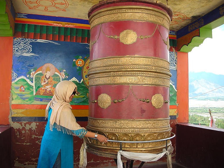 Spinning the Prayer Wheel. Spin the Wheel in a clockwise direction for good luck.