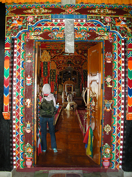 The doorway of the DUSHCHOT temple at Thiksey Monastery, with inlay work in various hues.