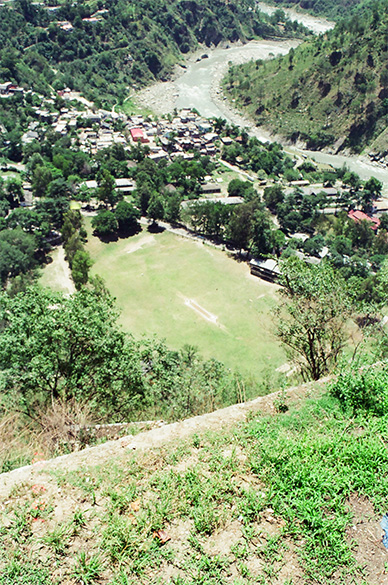 A cricket ground clicked from the temple top. Chamba town was founded by King Sahilvarman.