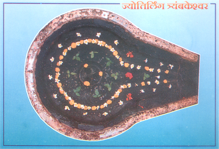 A postcard of Tryambakeshwar jyotirling. The three yellow spots that you see represent Brahma, Vishnu & Mahesh.