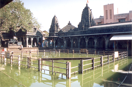 What you see is Kushavarta. Before going to the temple you are supposed to take a dip in this kund in order to purify yourself. Shreemant Rao Sahib Parnekar has built up the banks with stone pavement and verandahs on all sides. Water is clean. There are a