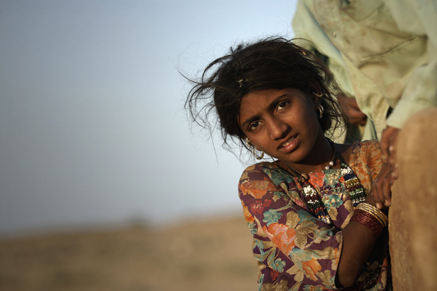 "<font color=""#f0d5a6"">An Indian girl</font> <br />An Indian girl in the Great Indian Desert. The Great Indian Desert lies mostly in the Indian state of Rajasthan, and extends into the northern part of Haryana and Punjab states and into southern Gujarat state. In Pakistan, the desert covers eastern Sindh province and the southeastern portion of Pakistan&rsquo;s Punjab province."